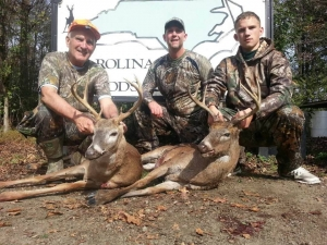 Happy hunters and  big North Carolina deer